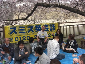 Talking with students under the blossoms in Osaka Castle Park